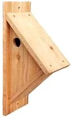 A cedar birdhouse for chickadees, nuthatches and downy woodpeckers.