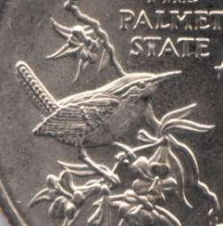 A series of US minted quarters honor various states, this one for the South Carolina State Bird